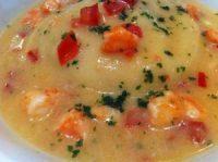 Raviolino farcito provola e crostacei profumati agli agrumi in guazzetto di mare